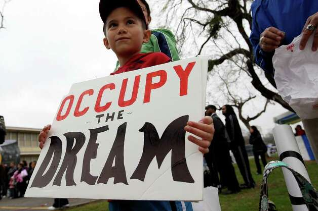 Robert Quijano, 7, gets ready to march with the Occupy San Antonio group in the Martin Luther King, Jr., 25th annual Commemorative March, Monday, Jan. 16, 2012. Photo: JERRY LARA, San Antonio Express-News / SAN ANTONIO EXPRESS-NEWS