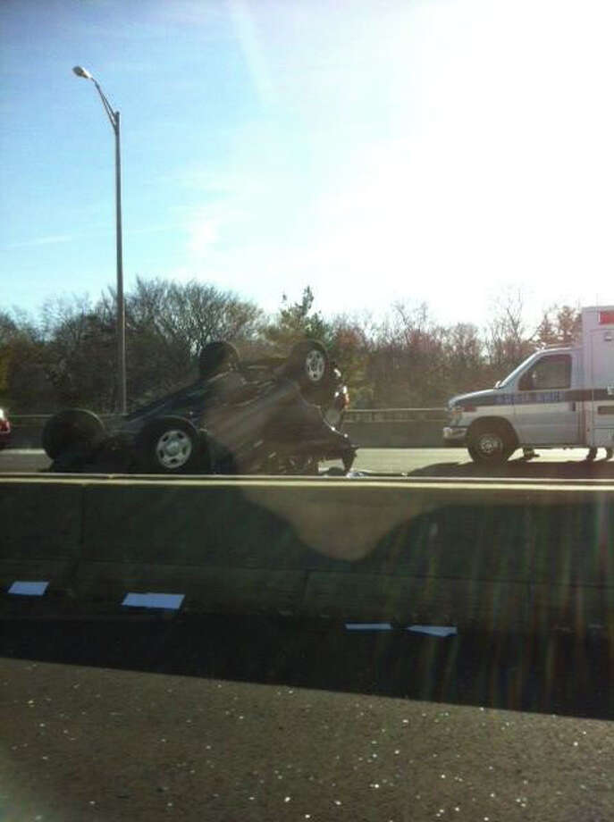 A photo sent to WTNH via ReportIt shows a car that rolled over on I-95 in Greenwich on Monday, January 16, 2011. Photo: WTNH Report It Photo