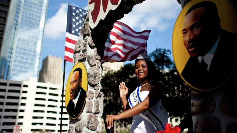 "Ja' Quavia Steward, 13, left, and Jasper Thomas, 15, get ready to walk hold a Martin Luther King banner for the 34th Annual ""Original"" Dr. Martin Luther King Birthday Parade and Celebration Monday, Jan. 16, 2012, in Houston. Photo: Nick De La Torre, Houston Chronicle / © 2012  Houston Chronicle"
