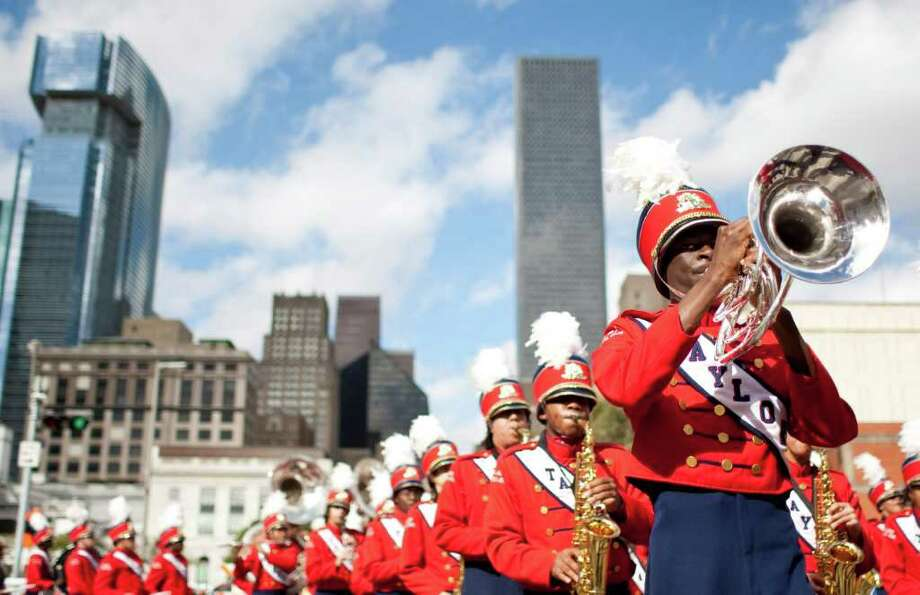 "The Alief Taylor High School marching band winds it's way through the streets of downtown as they play in the 34th Annual ""Original"" Dr. Martin Luther King Birthday Parade and Celebration Monday, Jan. 16, 2012, in Houston. Photo: Nick De La Torre, Houston Chronicle / © 2012  Houston Chronicle"