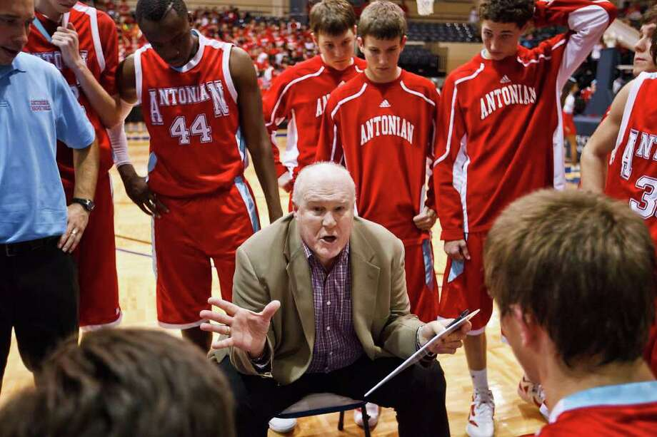 Antonian basketball coach Charlie Boggess talks to his team during a time out in their game with Central Catholic at Greehey Arena.  Photo by Marvin Pfeiffer Photo: MARVIN PFEIFFER, Marvin Pfeiffer/Prime Time Newspapers / Prime Time Newspapers 2011