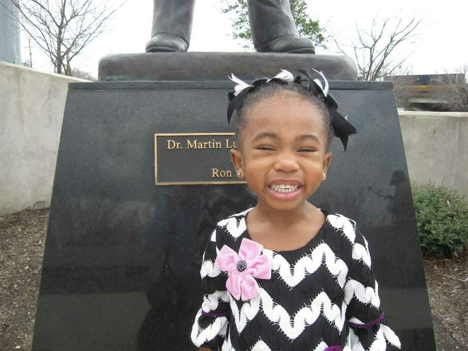 MLK Jr. Park1050 College St.commemorative plaque, statue, display wall, and parking(File photo) Imani Johnson, 3, visits the Rev. Martin Luther King Jr. Park on Monday with her godfather, Edward Petty. Imani stands in front of King's statute, erected in 2008 in the park overlooking Rev. Martin Luther King Jr. Parkway. Dan Wallach/The Enterprise Photo: Dan Wallach