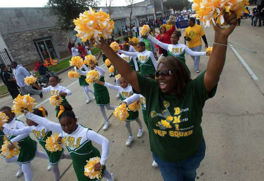 Cheerleaders from the Beatrice Mayes Institute perform during the Martin Luther King Day parade on San Jacinto St., Monday, Jan. 16, 2012, in Houston. Photo: Cody Duty, Houston Chronicle / © 2011 Houston Chronicle