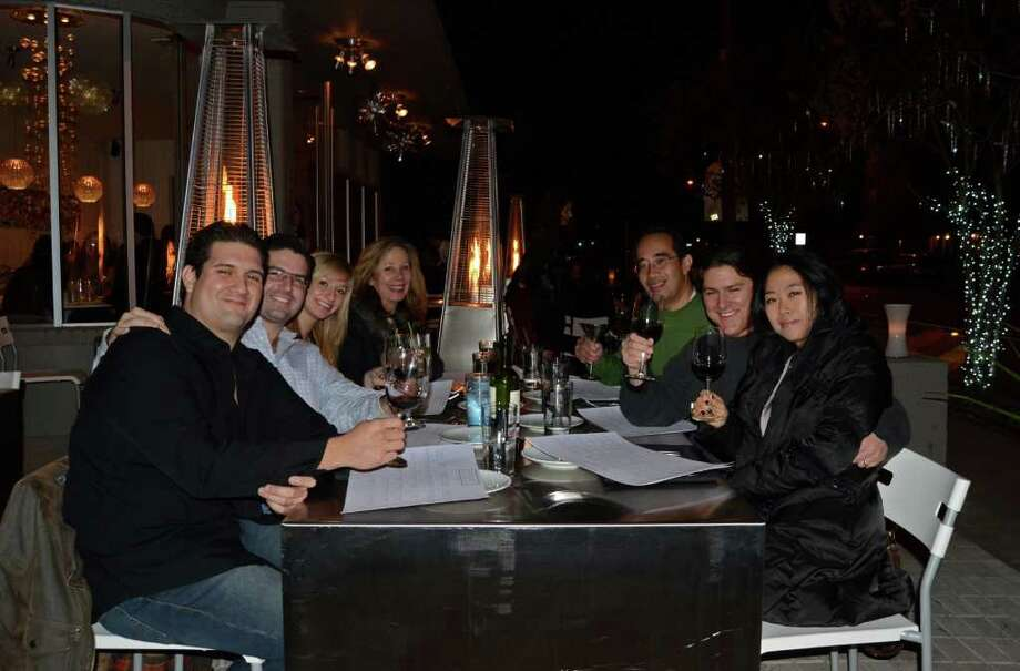 Manny Escobar (from left), Charles Riley, Amy Renk (cq), Kim Mares (cq), Claro Villanueva (cq), Epseshe Juglans (cq) and JS Kim (cq) have their wine on the patio of Feast on December 30, 2011. Robin Johnson