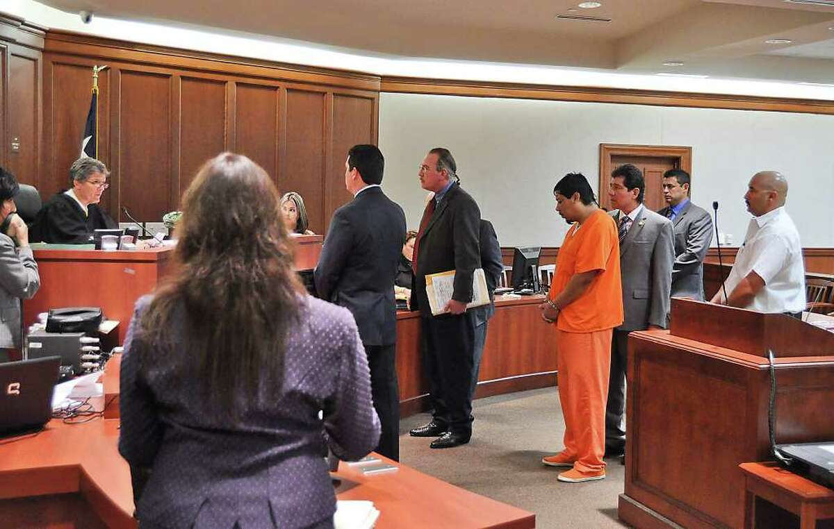 """Visiting Judge Robert """"Bert"""" Richardson, left, listens as Isidro """"Chilo"""" Alaniz, second from left with back to camera, announced Monday morning that his office will not seek the death penalty in the case of Gabriel Alvarez Briones, standing with orange suit. Alvarez Briones is accused of killing his infant cousin. One of the defense attorneys for Alvarez Briones, Eddie Peña, third from left, and his father Oscar Peña were on hand for the hearing."""