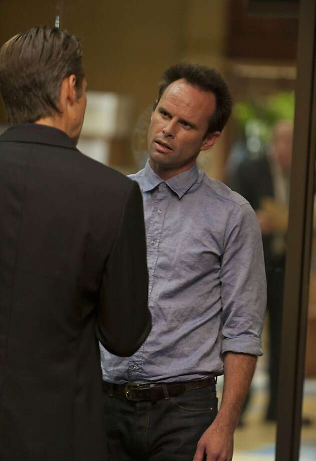 JUSTIFIED: Episode 301: THE GUNFIGHTER (Airs Jan. 17, 10:00 PM ET/PT). Pictured: Timothy Olyphant and Walton Goggins. CR: Prashant Gupta / FX. Photo: Prashant Gupta, FX