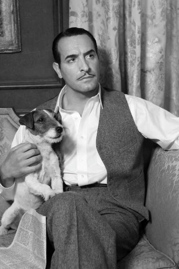 "Jean Dujardin plays George Valentin in ""The Artist."" Uggie the Jack Russell terrier plays his sidekick. Photo: The Weinstein Co."