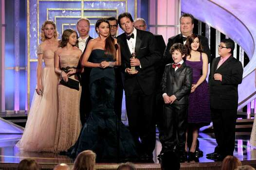 "In this image released by NBC, Sofia Vergara, center left, and producer Steve Levitan accept the award Best Television Series - Comedy Or Musical for ""Modern Family"" during the 69th Annual Golden Globe Awards on Sunday, Jan. 15, 2012 in Los Angeles. Photo: AP"
