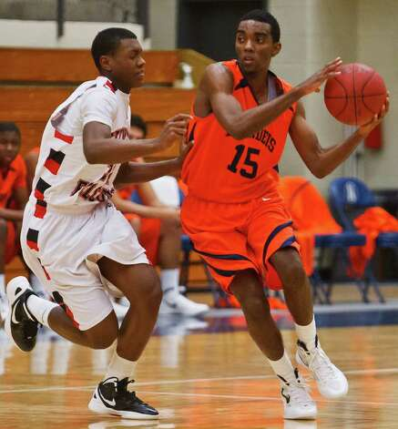 Brandeis guard Justin Graham (right) averaged 23.5 points as the Broncos went 2-0 last week. Photo: Prime Time Newspapers, Marvin Pfeiffer / Prime Time Newspapers 2012