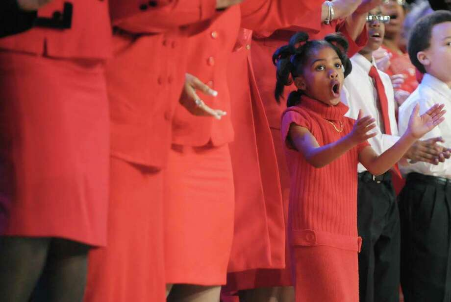 Sanavia McCann, 6, with the Capital District Community Voices of Praise Choir, performs with the choir at the New York State Dr. Martin Luther King, Jr. Memorial Observance at the Empire State Plaza Convention Center on Monday, Jan. 16, 2012 in Albany, NY.  Monday also was Sanavia's birthday.    (Paul Buckowski / Times Union) Photo: Paul Buckowski