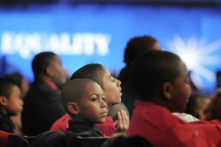 Jamol Franklin, 8, a member of the Albany Community Charter School Drill Team, listens to a speaker with other members of the drill team at the New York State Dr. Martin Luther King, Jr. Memorial Observance at the Empire State Plaza Convention Center on Monday, Jan. 16, 2012 in Albany, NY. The drill team was at the event to take part in a march to Lincoln Park.  (Paul Buckowski / Times Union) Photo: Paul Buckowski