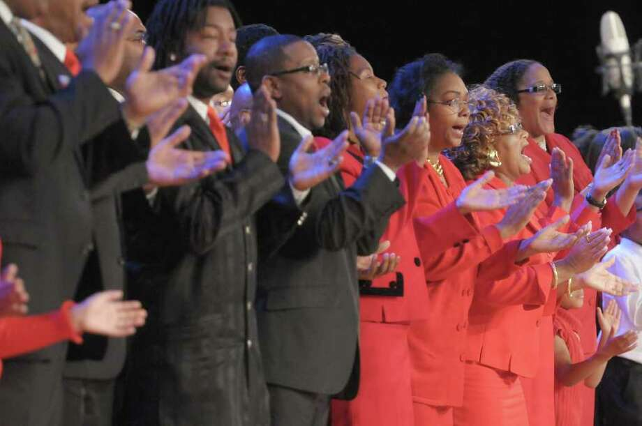 Members of the Capital District Community Voices of Praise Choir perform at the New York State Dr. Martin Luther King, Jr. Memorial Observance at the Empire State Plaza Convention Center on Monday, Jan. 16, 2012 in Albany, NY.     (Paul Buckowski / Times Union) Photo: Paul Buckowski