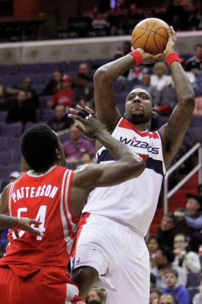 Washington Wizards forward Andray Blatche, right, shoots while guarded by Houston Rockets forward Pa