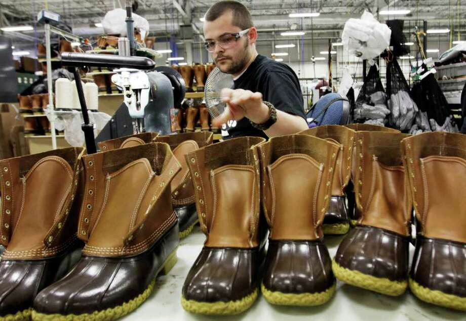 In this Dec. 14,  2011 photo, Eric Rego, of E. Boothbay, Maine, stitches boots in the facility where L.L. Bean boots are assembled in Brunswick, Maine. L.L. Bean's famed hunting boots are seeing a surge in popularity, necessitating the hiring of more than 100 additional employees to make them. Photo: AP