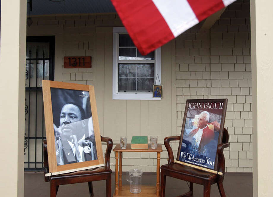 A portait of Martin Luther King, Jr. (left) and a portrait of Pope John Paul II (right) are on the front porch of the home of George Bernal at 1311 Martin Luther King Blvd. where the Martin Luther King, Jr. march took place January 16, 2012. Bernal said he admires King and the fomer Pope because of their desire to help everyday people. Photo: JOHN DAVENPORT, John Davenport / SAN ANTONIO EXPRESS-NEWS (Photo can be sold to the public)