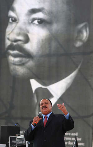 Martin Luther King III, the second oldest child of Martin Luther King, Jr. and Coretta Scott King, speaks to the crowd gathered at Pittman Sullivan Park on the Martin Luther King, Jr. holiday. Photo: JOHN DAVENPORT, John Davenport / SAN ANTONIO EXPRESS-NEWS (Photo can be sold to the public)