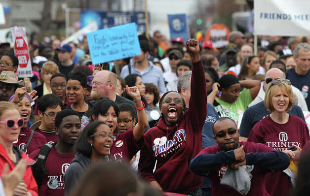 Trinity University students (bottom, foreground) take part in the Martin Luther King, Jr. March as marchers come close to Pittman Sullivan Park. Photo: JOHN DAVENPORT, John Davenport / SAN ANTONIO EXPRESS-NEWS (Photo can be sold to the public)
