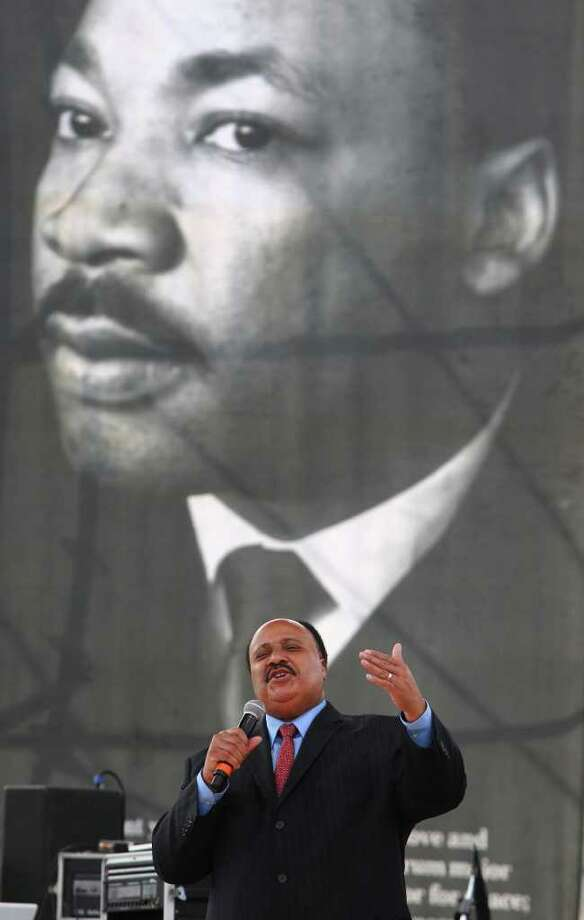 Martin Luther King III, the second oldest child of Martin Luther King, Jr. and Coretta Scott King, speaks to the crowd gathered at Pittman Sullivan Park on the Martin Luther King, Jr. holiday. (Monday January 16, 2012) JOHN DAVENPORT/jdavenport@express-news.net Photo: JOHN DAVENPORT, SAN ANTONIO EXPRESS-NEWS / SAN ANTONIO EXPRESS-NEWS (Photo can be sold to the public)