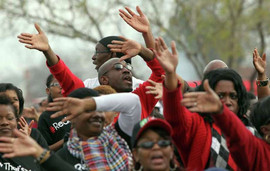 Faithful at the Martin Luther King, Jr. Commemorative Program wave their arms at Pittman Sullivan Park while gospel music plays on Martin Luther King Day. JOHN DAVENPORT/jdavenport@express-news.net Photo: JOHN DAVENPORT, SAN ANTONIO EXPRESS-NEWS / SAN ANTONIO EXPRESS-NEWS (Photo can be sold to the public)