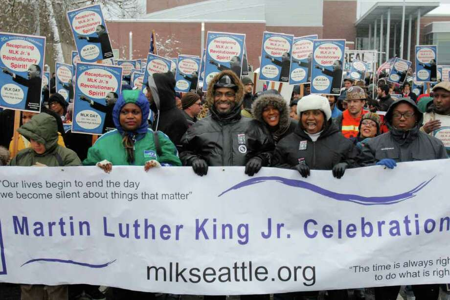People march in celebration of Dr. Martin Luther King Jr.'s birthday. This particular celebration is in its 30th year and is themed to recapture Martin Luther King Jr.'s Revolutionary Spirit. Hundreds march from Garfield High School to the Federal Building via Union St. and Madison St. in Seattle on Monday, Jan. 16, 2012 Photo: JOE DYER / SEATTLEPI.COM