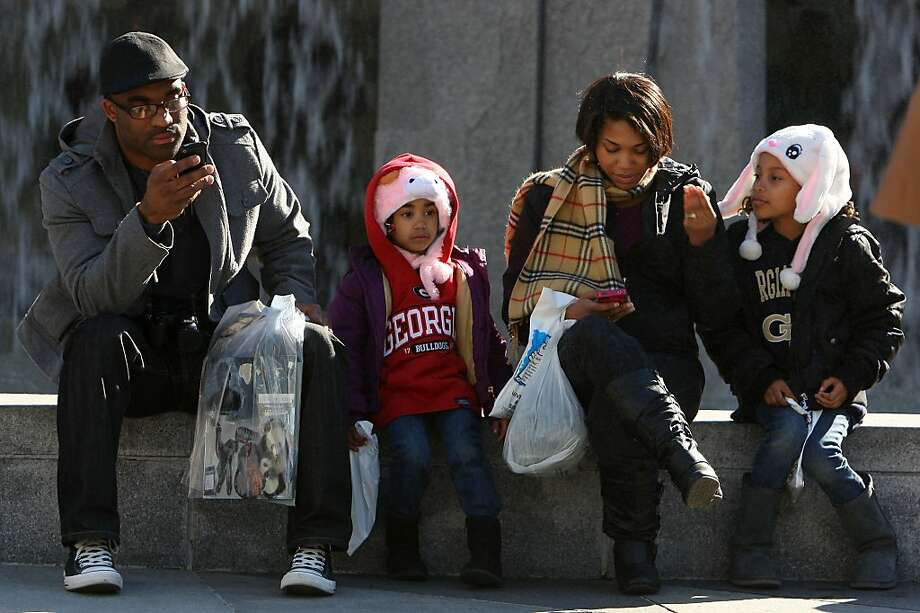 Left to right--Richard Morris, Imani Morris, 4 years old, Raquel Morris, Hailey Morris, 7years old, coming from Stockton at the Martin Luther King Jr. Memorial at Yerba Buena gardens in San Francisco, Calif., on Monday, January 16, 2012. Photo: Liz Hafalia, The Chronicle