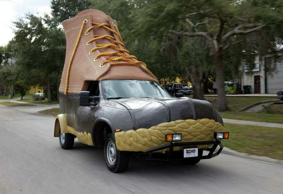In this Jan. 13, 2012 photo provided by L.L. Bean, the so-called Bootmobile is driven down a street in Kissimmee, Florida. In 1912 L.L. Bean sold his first pair of boots. The privately held company expects to have $1.5 billion in sales in its 2011 fiscal year. The bootmobile was created to help the company celebrate being in business for 100 years. Photo: AP