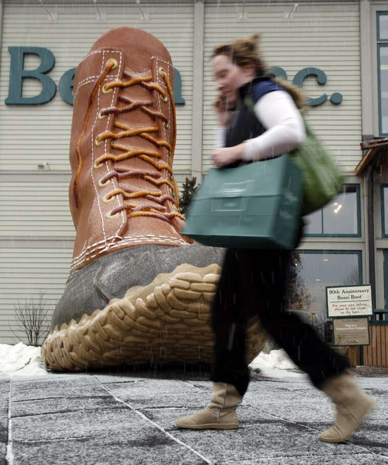 In this 2009 file photo a shopper passes by the famous replica of the L.L. Bean boot outside the company's headquarters in Freeport, Maine. Photo: AP Photo/Pat Wellenbach