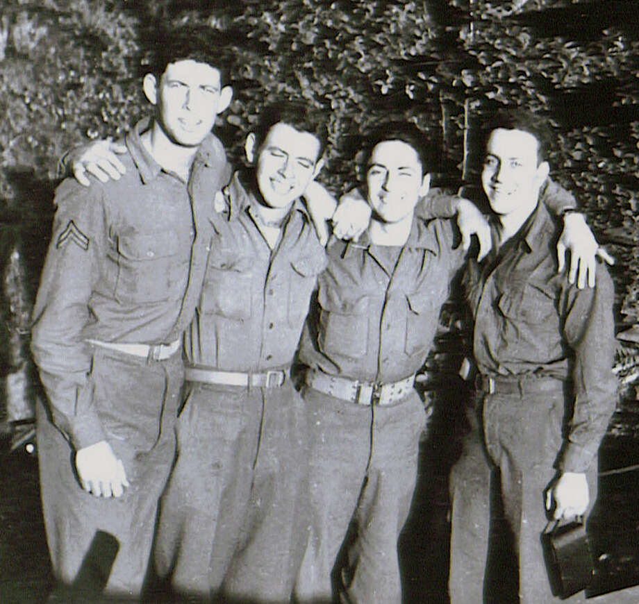 Len Kritzer, far left, in 1945 in Regensburg, Germany with three buddies from the Army's 286th Field Artillery Observation Battalion. Kritzer on Thursday will receive France's highest honor for his role in liberating the country from Nazi occupation in 1944. Photo: Contributed Photo
