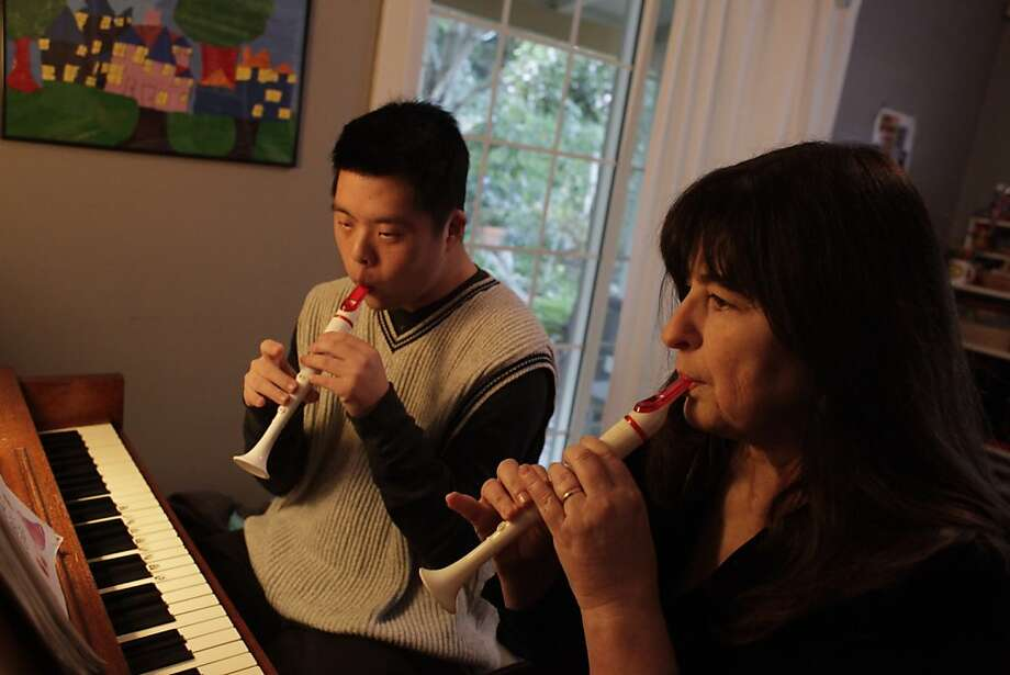 Linn Brown (right), who teaches non traditional music classes, plays a duet with Aaron Han (left), who has Down Syndrome, on their flutes during his regular weekly music lesson, at her home on Tuesday, January 10, 2012 in Oakland, Calif. Brown works with students who she describes as intellectually different. Photo: Lea Suzuki, The Chronicle