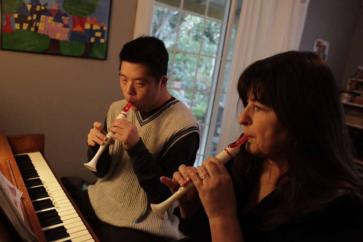 Linn Brown (right), who teaches non traditional music classes, plays a duet with Aaron Han (left), who has Down Syndrome, on their flutes during his regular weekly music lesson, at her home on Tuesday, January 10, 2012 in Oakland, Calif. Brown works with students who she describes as intellectually different.