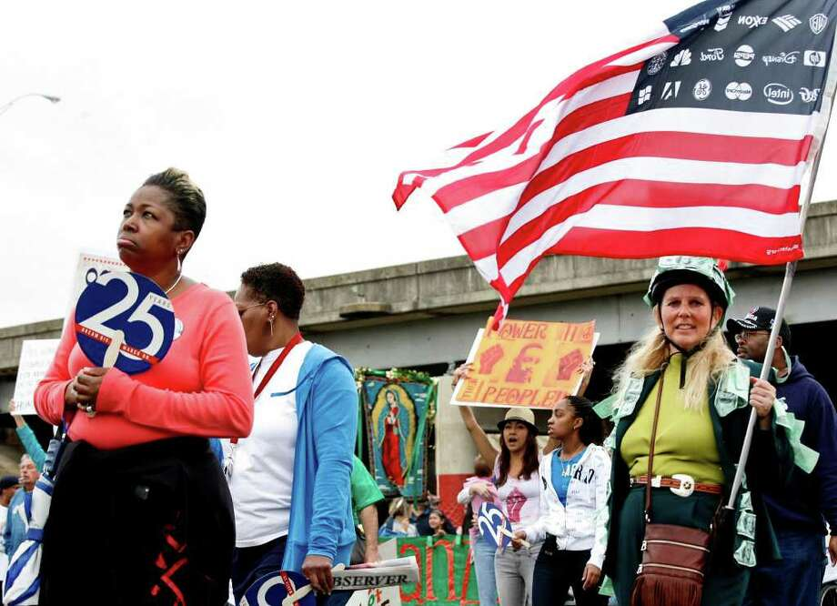 metro - Michele Petty, right, a supporter of Occupy SA, marches during the Martin Luther King, Jr. March in San Antonio on Monday, Jan. 16, 2012. BRIA WEBB/For the Express-News Photo: BRIA WEBB , SAN ANTONIO EXPRESS-NEWS / Bria Webb