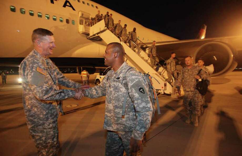 Maj. Gen. Eddy Spurgin of the Texas National Guard greets Sgt. Alberto Segarra of San Antonio upon arrival at Biggs Army Airfield, El Paso, in July 2010. The guard's 72nd Infantry Brigade Combat Team had just returned from a nine-month deployment to Iraq. Photo: Houston Chronicle File Photo / Houston Chronicle