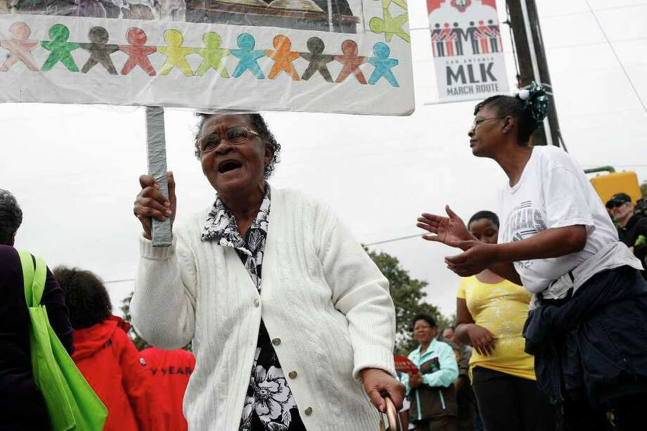 "metro - ""Keep on marching,"" Clara Hunt, a participant since the first San Antonio Martin Luther King Jr. March, chants during the Martin Luther King, Jr. March in San Antonio on Monday, Jan. 16, 2012. BRIA WEBB/For the Express-News Photo: BRIA WEBB , SAN ANTONIO EXPRESS-NEWS / Bria Webb"