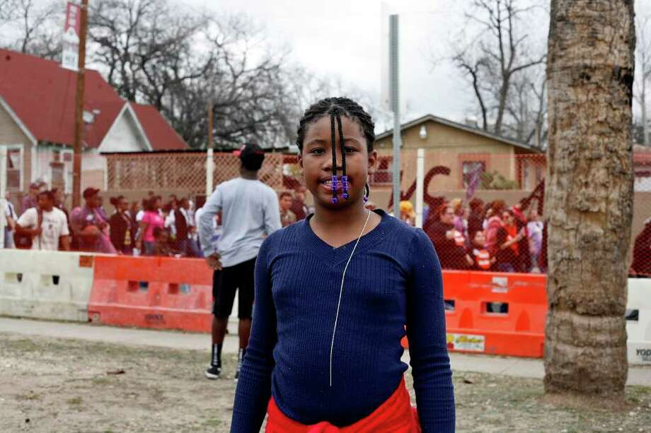 metro - Tyra Wlkins, 11, poses for a picture during the Martin Luther King, Jr. March in San Antonio on Monday, Jan. 16, 2012. BRIA WEBB/For the Express-News Photo: BRIA WEBB , SAN ANTONIO EXPRESS-NEWS / Bria Webb