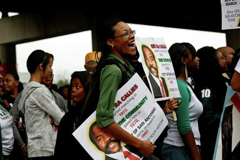 metro - Robin Wilson laughs while being interviewed during the Martin Luther King, Jr. March in San Antonio on Monday, Jan. 16, 2012. BRIA WEBB/For the Express-News Photo: BRIA WEBB , SAN ANTONIO EXPRESS-NEWS / Bria Webb