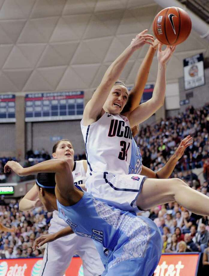 Connecticut's Kelly Faris (34) grabs a rebound during the first half of an NCAA college basketball game in Storrs, Conn., on Monday, Jan. 16, 2012. (AP Photo/Fred Beckham) Photo: Fred Beckham/Associated Press / FR153656 AP