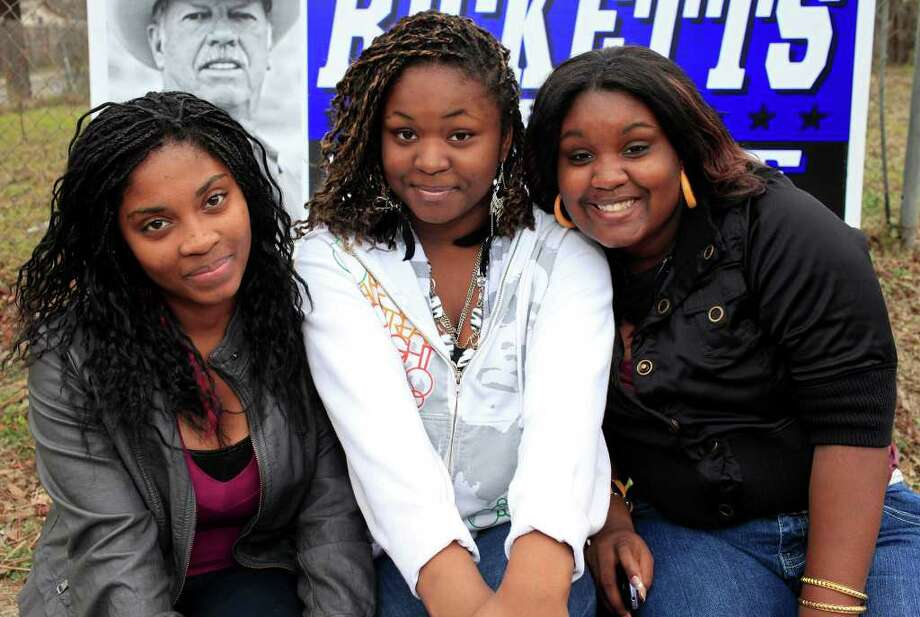 From the left, Keiana Chambers, sisters Jaden and Jalaya Miller at the MLK March, honoring Martin Luther King, Jr., Monday, January 16, 2012 on the Eastside in San Antonio. Photo: J. MICHAEL SHORT, SPECIAL TO THE EXPRESS-NEWS / THE SAN ANTONIO EXPRESS-NEWS