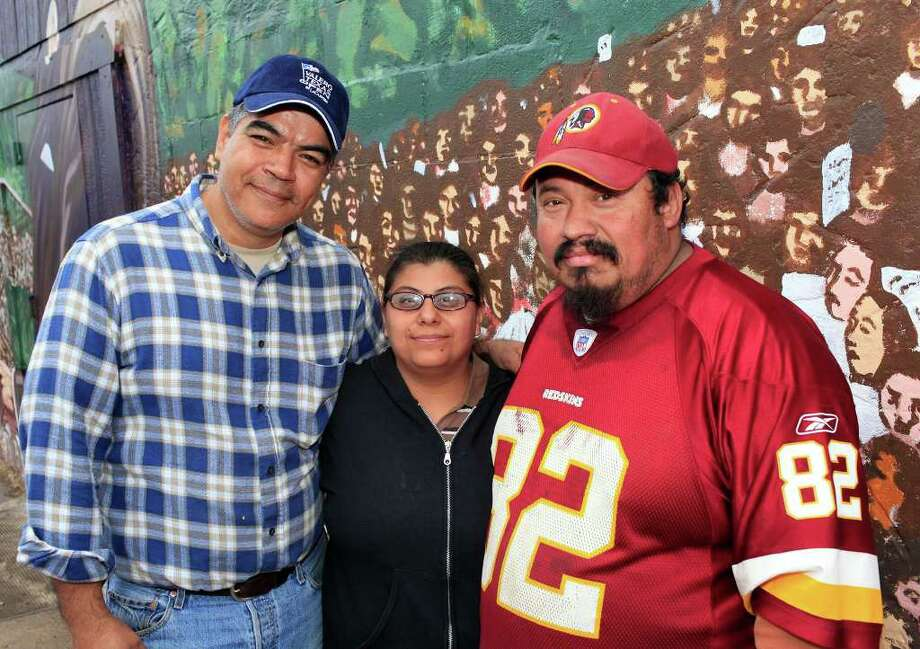 From the left, Francisco Saenz, Sabrina Gaytan and Gilbert Jaramillo at the MLK March, honoring Martin Luther King, Jr., Monday, January 16, 2012 on the Eastside in San Antonio. Photo: J. MICHAEL SHORT, SPECIAL TO THE EXPRESS-NEWS / THE SAN ANTONIO EXPRESS-NEWS