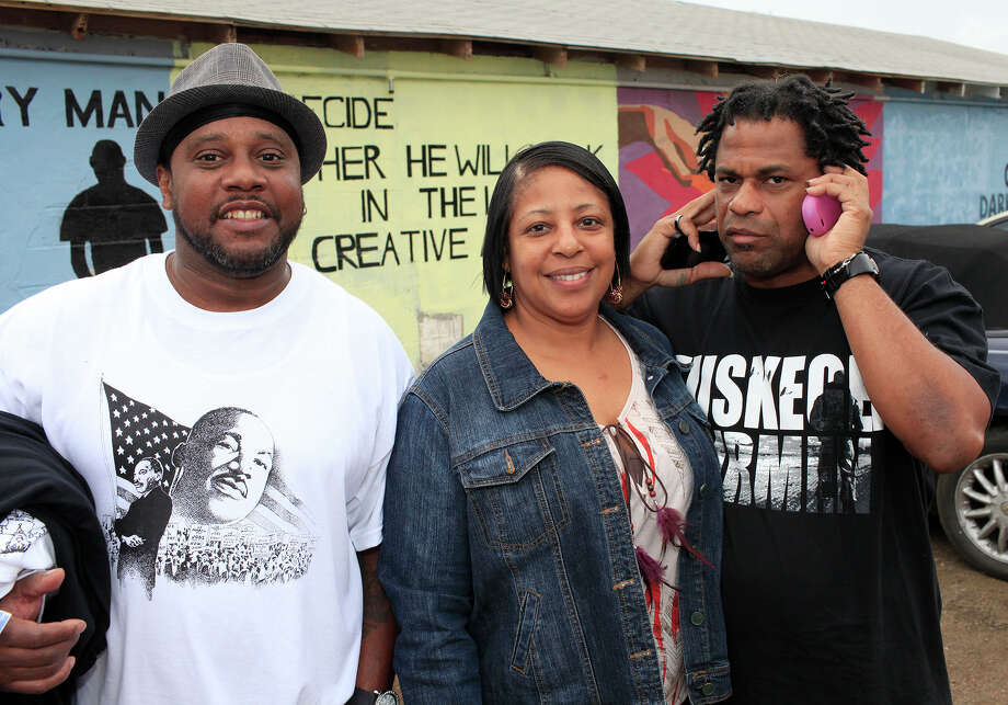 From the left, Mike Williams, Shawn Bacon Willis and Dwayne Mahon at the MLK March, honoring Martin Luther King, Jr., Monday, January 16, 2012 on the Eastside in San Antonio. Photo: J. MICHAEL SHORT, SPECIAL TO THE EXPRESS-NEWS / THE SAN ANTONIO EXPRESS-NEWS