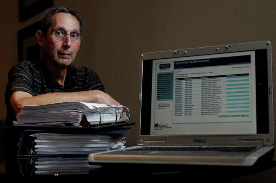 M.D. Anderson Cancer Center patient Ed Steger, now has access to his medical records, including doctor's notes, online through a hospital website.  One notebook of paper copies contains 14 months of his records. Photo: Melissa Phillip / © 2011 Houston Chronicle