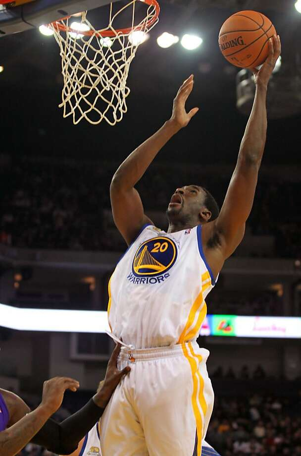 Golden State Warriors' Ekpe Udoh (20) shoots during their pre-season game with the Scramento Kings in Oakland, Calif., Saturday, December 17, 2011. Photo: Lance Iversen, The Chronicle