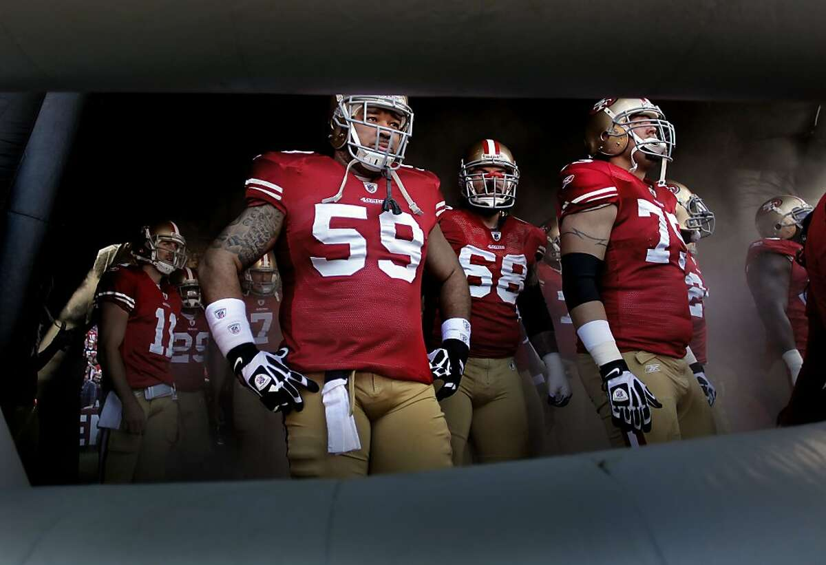 49ers' center Jonathan Goodwin, (59) waiting inside the giant inflatable helmet to be introduced, as the San Francisco 49ers prepare to take on the New Orleans Saints in the NFC divisional playoffs, on Saturday Jan. 14, 2012, in San Francisco, Ca.