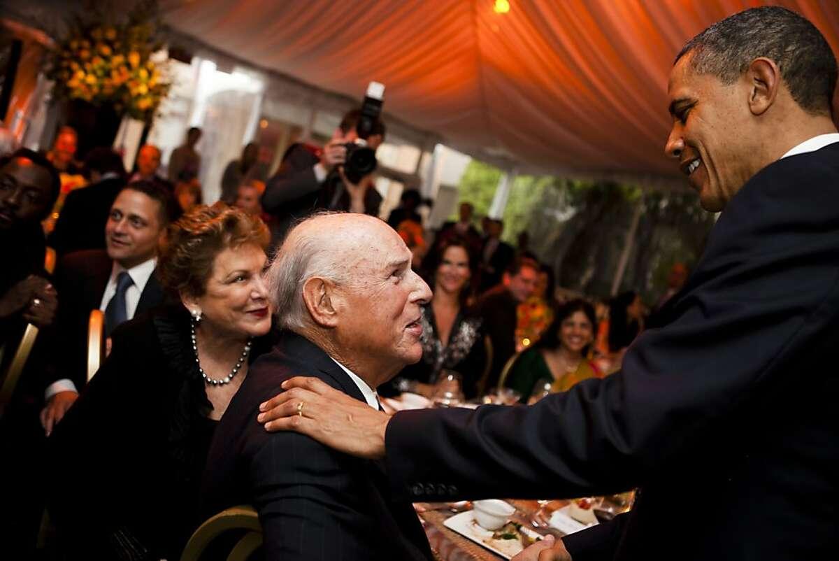 Marc Benioff, seated, with President Barack Obama.