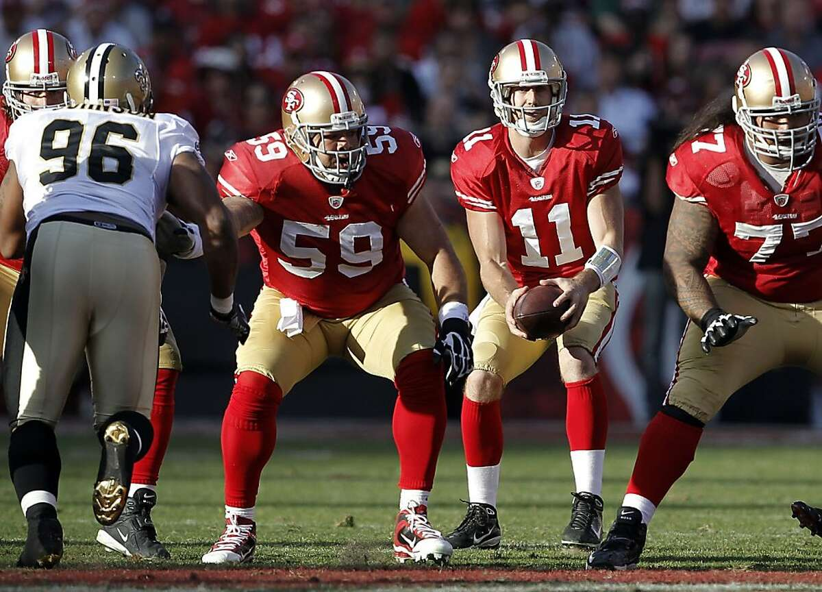 49ers' center Jonathan Goodwin, (59) snaps the ball to quarterback Alex Smith (11) as the San Francisco 49ers take on the New Orleans Saints in the NFC divisional playoffs, on Saturday Jan. 14, 2012, in San Francisco, Ca.