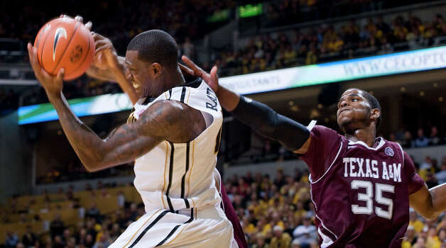 Missouri's Ricardo Ratliffe, left, pulls down a rebound next to Texas A&M's Ray Turner during the second half of an NCAA college basketball game Monday, Jan. 16, 2012, in Columbia, Mo. Missouri won 70-51. Photo: Associated Press, L.G. Patterson / FR23535 AP