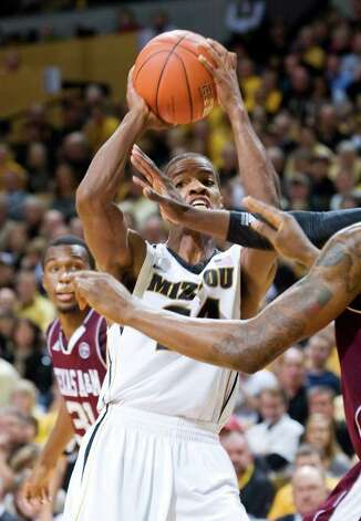 Missouri's Kim English, right, looks for help after he dribbled by Texas A&M's Elston Turner, left, during the second half of an NCAA college basketball game Monday, Jan. 16, 2012, in Columbia, Mo. Missouri won 70-51. Photo: Associated Press, L.G. Patterson / FR23535 AP