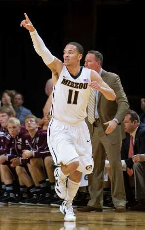 Missouri's Michael Dixon celebrates after making a 3-point shot during the first half of an NCAA college basketball game against Texas A&M on Monday, Jan. 16, 2012, in Columbia, Mo. Photo: Associated Press, L.G. Patterson / FR23535 AP