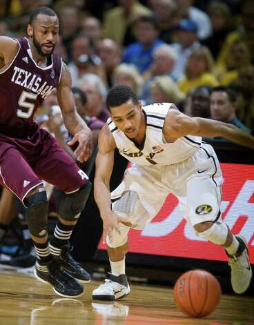 Missouri's Phil Pressey, right, and Texas A&M's Dash Harris, left, scramble for a loose ball during the first half of an NCAA college basketball game Monday, Jan. 16, 2012, in Columbia, Mo. Photo: Associated Press, L.G. Patterson / FR23535 AP