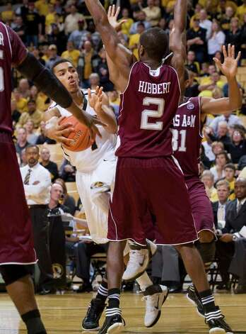 Missouri's Phil Pressey, left, passes the ball behind Texas A&M's Naji Hibbert (2) as Elston Turner, right rear, helps on defense during the second half of an NCAA college basketball game Monday, Jan. 16, 2012, in Columbia, Mo. Missouri won 70-51. Photo: Associated Press, L.G. Patterson / FR23535 AP