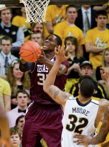 Texas A&M's Elston Turner, left, shoots over Missouri's Steve Moore, right, during the second half of an NCAA college basketball game Monday, Jan. 16, 2012, in Columbia, Mo. Missouri won 70-51. Photo: Associated Press, L.G. Patterson / FR23535 AP